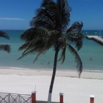 beachside condo from pier in Sisal Yucatanpalm
