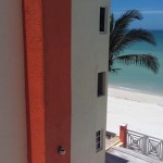 beachside condo from pier in Sisal Yucatansideofbuilding