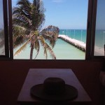 beachside condo from pier in Sisal Yucatanwindowview