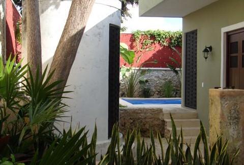 Garden and pool at San Juan Park Colonial in Merida Yucatan
