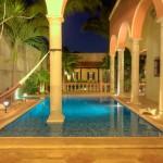 swimming pool at night Hacienda style home for sale in Merida Yucatan